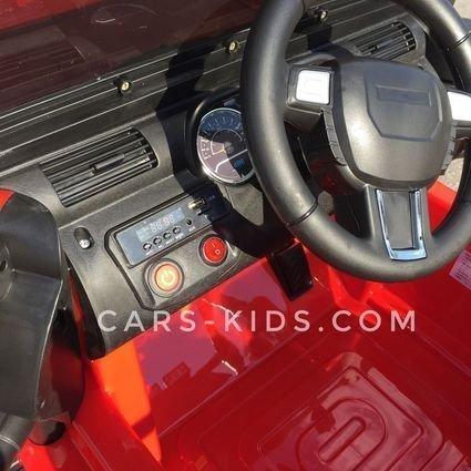 Электромобиль Jeep Wrangler красный (полный привод, усиленный аккумулятор, резиновые колеса, кожаное кресло, пульт, музыка)