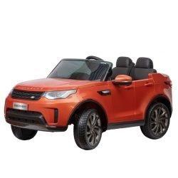 Электромобиль Land Rover Discovery оранжевый (колеса резина, кресло кожа, пульт, музыка)